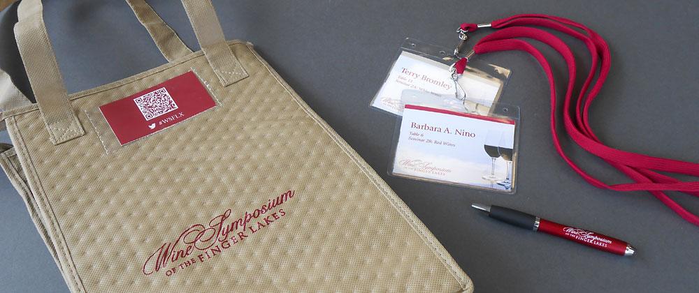 wine symposium finger lakes giftbag name badge pen